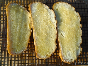 spread a generous amount of garlic-confit paste on sour dough bread (or your favorite bread)