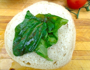 put some spinach on the bottom half of the bread