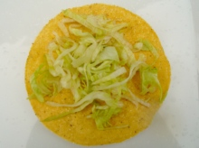 top fried tortilla with shredded lettuce