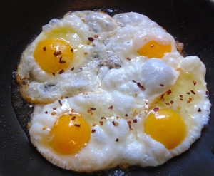 saute eggs according to your preference (I like mine crispy for this dish), season with kosher salt and chili flakes