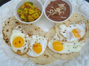 plate tortillas, top with eggs, sprinkle with chili flakes