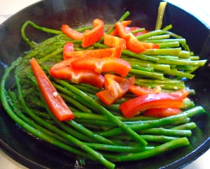 add blanched asparagus and raw peppers to the remaining oil, saute until heated through