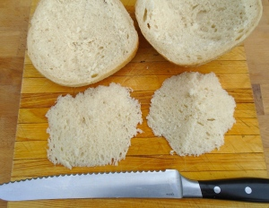 cut in half, remove some of the soft part (don't throw away, this is great to dunk into the pork juices)
