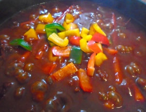 add diced bell peppers, simmer two more minutes