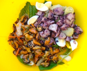 add octopus en escabeche, mussels en escabeche, olive oil, cider vinegar, garlic paste, kosher salt and cayenne pepper