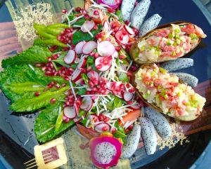 arrange salad, dragon fruit slices and baked potatoes nicely on platter, sprinkle with pomegranate-seeds