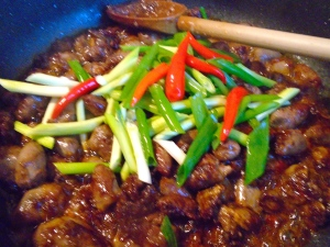 add scallions and whole pickled chilies