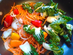 add baby bok choy, mild chilies, carrot julienne and onion julienne ,stir fry 1 more minute