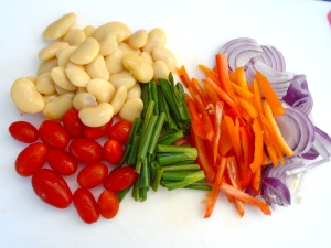 grape tomatoes, scallions, julienned peppers, julienned red onions, cooked beans
