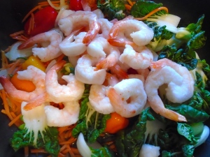 add shelled and deveined shrimp, stir fry another minute