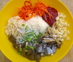 mix whole-grain penne, beef, kosher salt, cayenne pepper, carrot julienne, sliced scallions, ketchup, sliced chilies, GARLIC PASTE, heavy cream, shredded pepper jack, grated parmesan and diced swiss