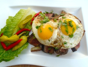 top caramelized onions with fried eggs