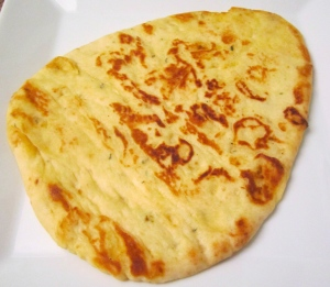 grill home made or store-bought naan until heated through