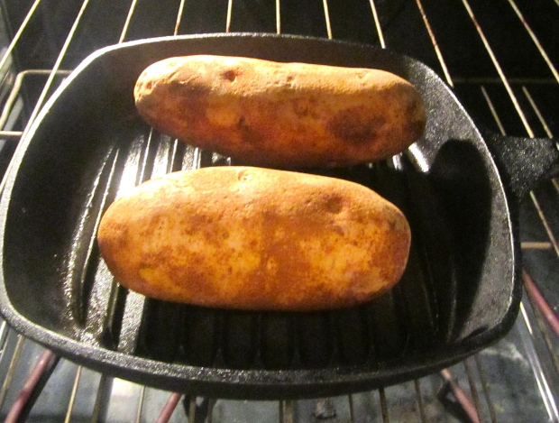 bake potatoes until soft in center, cut in half, remove flesh, lightly mash with grated asiago and diced gorgonzola