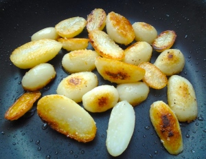 meanwhile, saute potatoes in garlic oil until golden