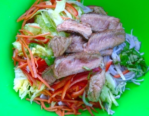 mix half of the steak, the noodles and the vegetables with the dressing