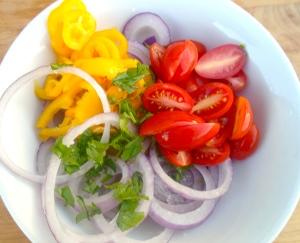 red onion julienne, chopped cilantro, grape tomatoes, mild chilies, kosher salt, cayenne pepper, garlic paste, cider vinegar, olive oil