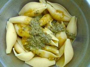 add pesto, white balsamic vinegar and a dash of maggi seasoning to fresh cooked pasta shells, mix, check / adjust seasoning, add grape tomatoes and seafood