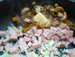 add whole butter, diced ham and diced onions, saute until onions are translucent