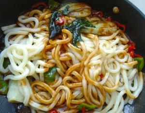 add udon and squid, check / adjust seasoning