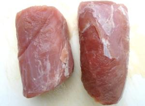clean a pork tenderloin of excess fat and all silver skin, cut in half