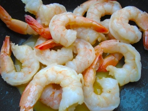 add peeled, deveined shrimp, season with kosher salt, saute until heated through, remove 2/3 of the shrimp and chili-butter, set aside, remove tails from remaining shrimp, chop coarsely