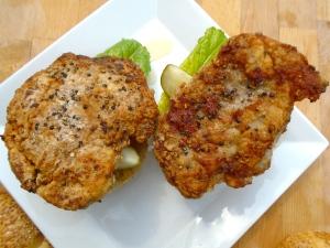 add schnitzel, top with top-half of rolls