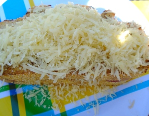 add a generous amount of grated cheese