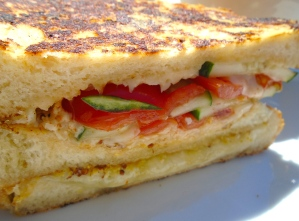 Swiss Melt On Sourdough Bread With Cucumber And Tomato