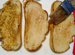 brush garlic oil on the two toasted sides of the bread which were toasted on one side only