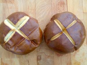 meanwhile, cut 2 pretzel-rolls into halves