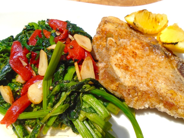 Cheese-Coated Pork Chop With Garlic-Broccolini And Charred Peppers
