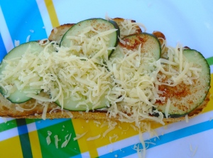 add the cucumber slices, sprinkle with grated cheese