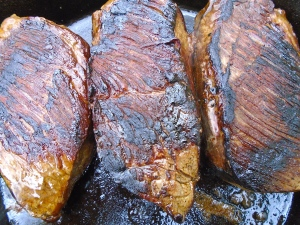 trimm four 10 oz strip steaks of all skin and fat, season with kosher salt and grd black pepper, saute or grill until done to your preference, let steaks rest at least 10 minutes before slicing