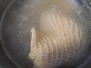 blanch 2 lbs tripe in lightly salted and vinegared water (one tblsp ea salt and vinegar per qt of water), repeat