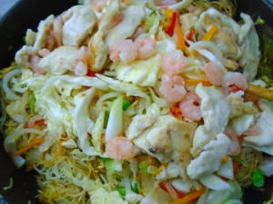 return the veggies, shrimp and chicken to the pan, add the seasoning/sauce, stir fry until all is well mixed