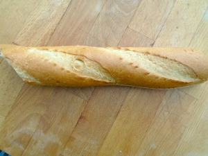 cut 1/2 fresh french baguette lengthwise in half, leaving it attached in the center by the crust