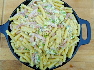 generously butter a baking dish or cast iron pan, add the pasta mix, sprinkle with parmesan cheese and bake in a 375F preheated oven until golden and cooked through; serves 6; serve with green salad and tomato sauce