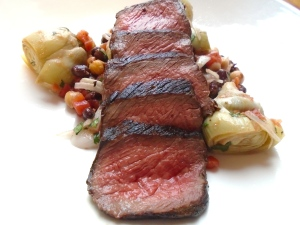 top each salad with one sliced steak; recipe serves 4