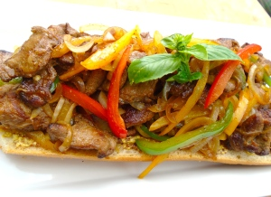 top baguette with the sauteed pork, onions and peppers