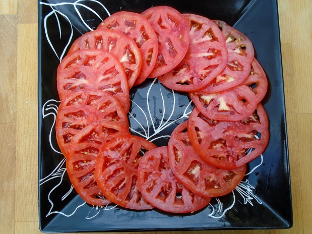 slice 2 large, very ripe tomatoes into fine slices, arrange on serving platter, sprinkle with sea salt to taste