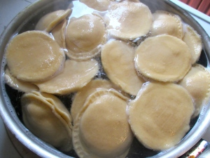 boil ravioli until done, about 5-7 minutes, depending on thickness and amount of filling, drain, toss with 3 tblsp olive oil