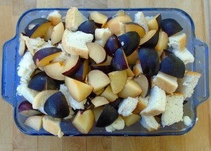 cut 10 THICK slices of day-old white bread into large cubes, mix with the plums, fill into ovenproof dish