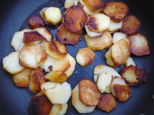 saute the potato slices in 1 tblsp olive oil until browned