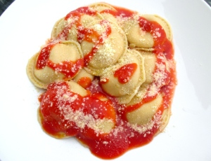 drizzle ravioli with more tomato sauce, sprinkle with parmigiano romano