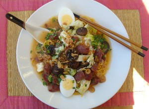 top the noodles with 1/4 of the soup, garnish with fried shallots, chopped cilantro and 2/2 boiled eggs ; recipe serves 4