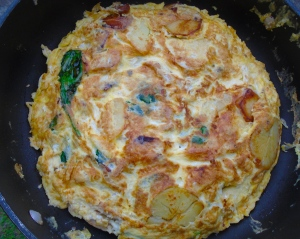 cook on low heat until eggs have set, flip eggs to other side, cook until lightly browned; serve with gherkins and small salad of greens and tomatoes in honey/yogurt dressing; serves 4
