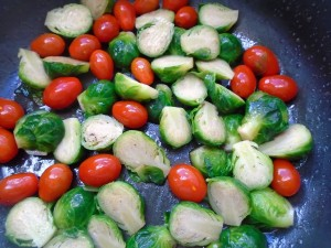 add the brussel sprouts and 1 cup grape tomatoes and 1/2 tblsp garlic paste, saute until heated through