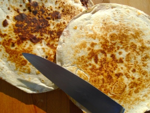 remove quesadilla to a cutting board, cut into 6 wedges