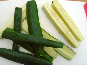 meanwhile, prepare the spicy cucumbers; cut 1 medium size cucumber on 4 sides, leaving and discarding the seedy center